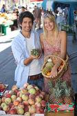 Couple at market — Stock Photo