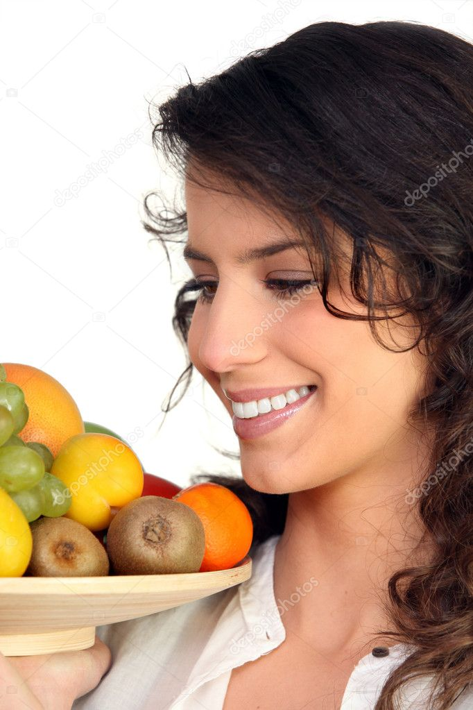 Woman carrying tray of fruits — Stock Photo #7945650