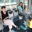 Two girls riding the tram - Stock Photo