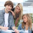 Students working outside college building — Stock Photo