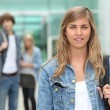 Students leaving school - Stockfoto
