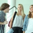 Teenagers talking in stairs — Stock Photo