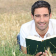 Stock Photo: Mreading outside