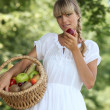 Stock Photo: Summery womwith basket of fruit