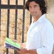 Male sightseer consulting a brochure — Stock Photo #7951681