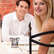 Man and woman dining at a restaurant — Stock Photo #7951744