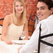 Cute young couple at restaurant — Stock Photo