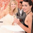 Stock Photo: Two female friends drinking champagne in restaurant