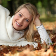 Woman lying in the leaves — Stock Photo #7951782