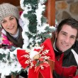Couple staying in a Christmas chalet — Stock Photo