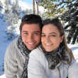 Couple skiing in the mountains — Stock Photo