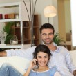 Couple in living-room — Stock fotografie