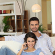 Foto Stock: Couple in living-room