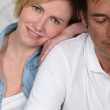 Couple lying dressed on their bed — Stock Photo #7952142