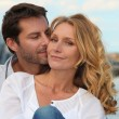 Stock Photo: Portrait of a couple by the sea