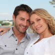 Couple by water — Stock Photo