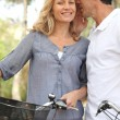 Foto Stock: Couple with bicycles