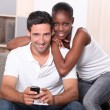 Stock Photo: Couple watching television