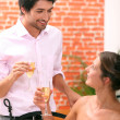 Couple drinking champagne in a restaurant — Stock Photo