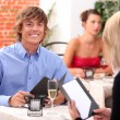 Couple having meal in restaurant — Stock Photo #7952685
