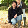 Couple going mushroom picking. - Stock Photo