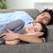 Couple asleep on sofa — Stock Photo #7952960