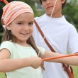 Stock Photo: Children with bow and arrow