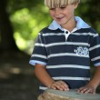 Stock Photo: Boy playing Africdrum