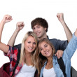 Three excited students — Stock Photo