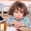 Stock Photo: Grumpy toddler waiting to eat pancakes