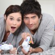 Foto Stock: Couple playing a video game