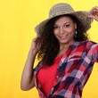 A cute African American model with a hat. — Stock Photo