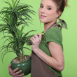 Stock Photo: Young womholding plant