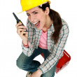 Female construction worker yelling into walkie-talkie — Stock Photo #7954240
