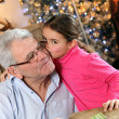 Grandfather and granddaughter at Christmas — Stock Photo