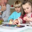 Stock Photo: Children painting plaster models