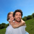 Man carrying a girl on his back — Stock Photo #7954622