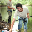 Stock Photo: Men fishing in river