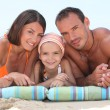 Stock Photo: Family laying on beach