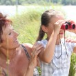 Little girl with pair of binoculars — Stock Photo