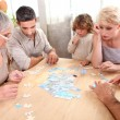 Family making puzzle — Stock Photo