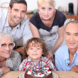 Family celebrating a birthday together — Stock Photo