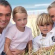 Stock Photo: Young family in the sand dunes