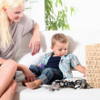 Carer watching  toddler, — Stock Photo