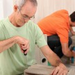Father and son putting together flatpack furniture — Stock Photo #7955405