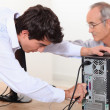 Stock Photo: Technician repairing a computer