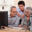 Stock Photo: Family on computer