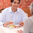 A boy and his grandmother at restaurant — Stock Photo