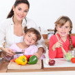 Kids cooking with their mother — Stock Photo #7955590