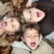 Stock Photo: Children lying on the ground